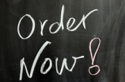 "Chalk drawing - ""Order  now"" word on the chalkboard"