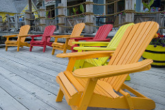 colourful chairs in a circle by Camille King is licensed under a Creative Commons Attribution 4.0 International License.